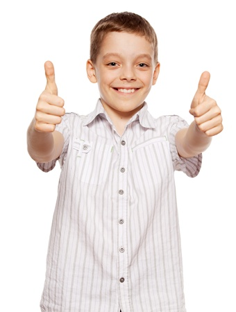Happy boy showing thumb up. Happiness child showing sign ok photo