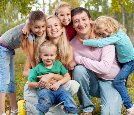 multiple family: Happy large family with children in autumn park Stock Photo
