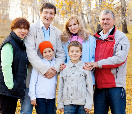 Families with children and grandparents in autumn park Stock Photo - 14754953