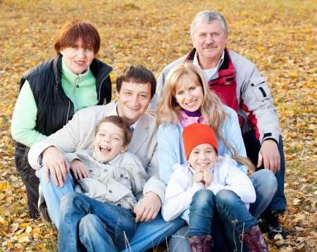 big family: Big family in autumn park. Mother, father, grandmother, grandfather and children outdoors