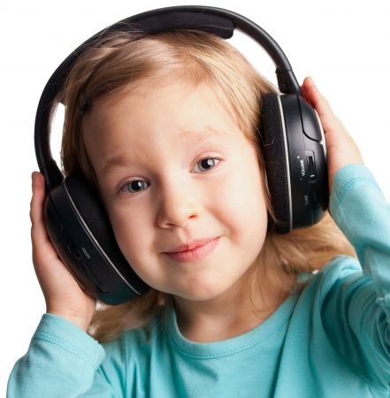 Little child in headphones isolated on white photo