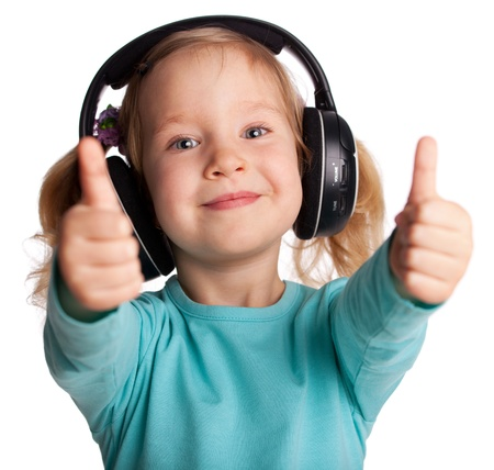 music listening: Happy child in headphones showing a thumb up