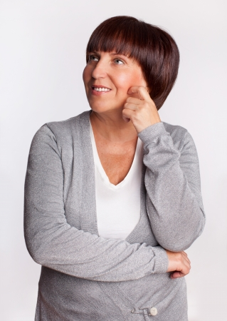 Portrait happy mature woman looking away photo