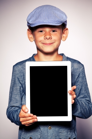 Happy boy with tablet computer. Child showing tablet photo