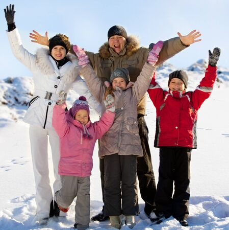 Family with children in the snow in winter. photo