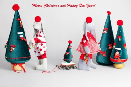 Hare dress up the tree. Christmas Card photo
