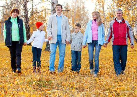 Families with children and grandparents in autumn park. Big family photo