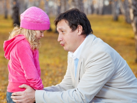 consoling: Sad child. Fater daughter regretting Stock Photo