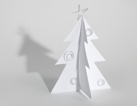Christmas tree made of paper. Christmas card photo