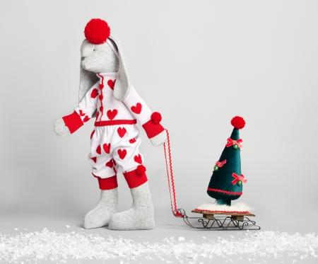 Hare dress up the tree. Christmas Card Stock Photo - 15088793