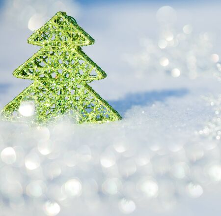 Christmas card. Christmas tree on snow. Winters background.  photo