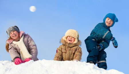 snowballs: Children in winter. Happy kids playing snowball