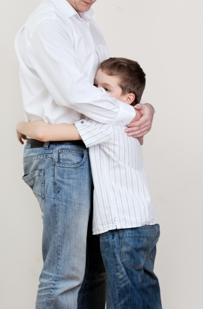 separation: Father comforts a sad child. Problems in the family. Pain Stock Photo