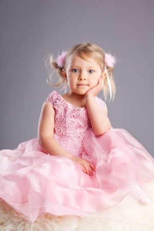 Beautiful little girl on a gray background Stock Photo - 16165787