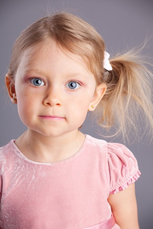 Beautiful little girl on a gray background Stock Photo - 16165737