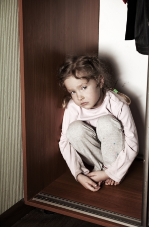 frightened: Sad girl. Depressed child at home. Problems at family