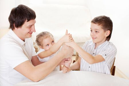 Happy dad playing with children at home. Father with kids - unity Stock Photo - 17283453