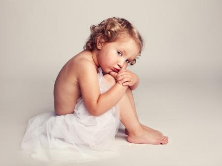 only girls: Whimsical capricious little ballerina. Glamour sad girl. Fashion child.