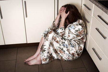 despair: Adult woman crying sitting on the floor. Hopelessness, depressions, sadness, stress, grief, loneliness, problems.