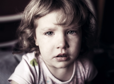 sad faces: Crying little girl. Abuse child.