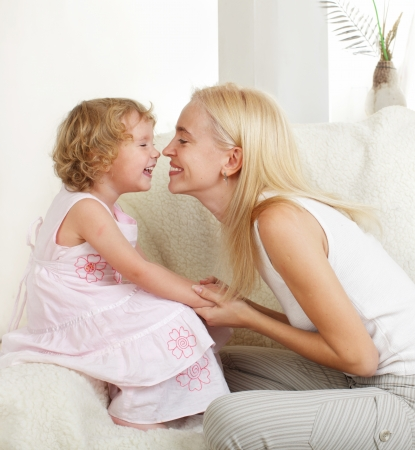 Happy mother with a daughter at home photo
