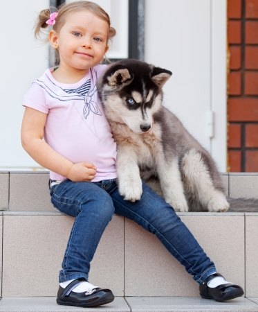 Child with a dog on the porch Stock Photo - 17891458