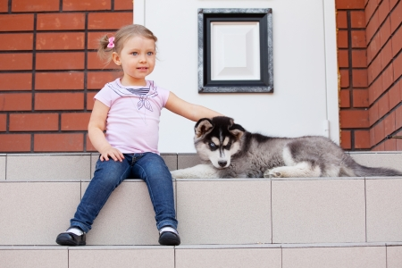 Child with a dog on the porch Stock Photo - 17891414