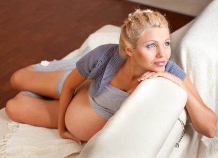 beautiful pregnant: Beautiful young pregnant woman at home Stock Photo