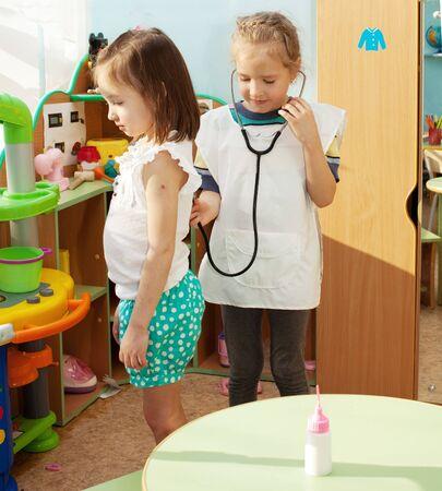 Child in kindergarten. Kids in nursery school. Girl playing at infant school Stock Photo - 17891464