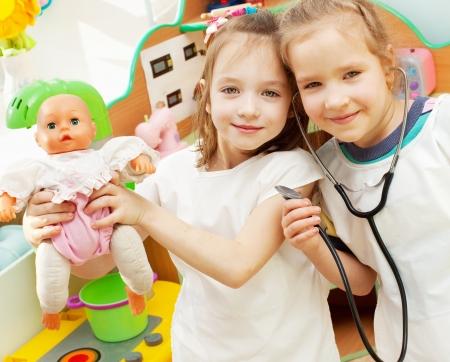 Child in kindergarten. Kids in nursery school. Girl playing at infant school Stock Photo - 17891450