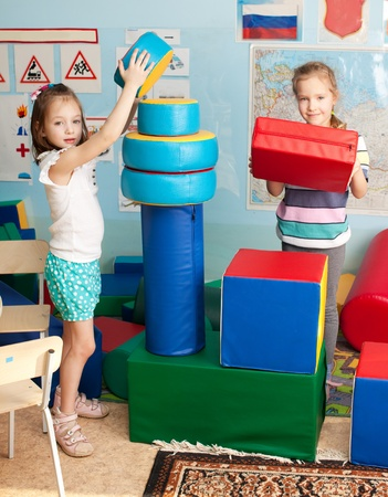 Children in kindergarten. Kids in nursery school. Girl playing box of bricks at infant school Stock Photo - 17891409