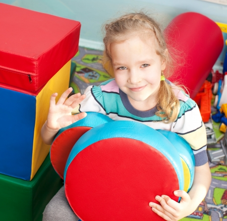 Children in kindergarten. Kids in nursery school. Girl playing box of bricks at infant school Stock Photo - 17891401