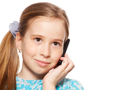 Girl, speaking on the phone. Child talking on mobile phone isolated on white backgraund photo