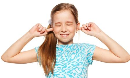 niños malos: Niño cerró los oídos. Retrato primer plano. Foto de archivo
