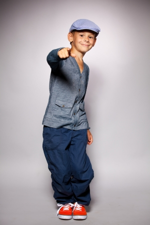 hip hop dance: Dancing boy. Fashion happy child in beautiful clothing Stock Photo