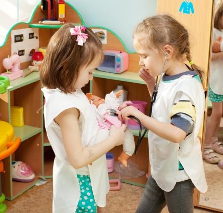 Child in kindergarten. Kids in nursery school. Girl playing at infant school photo
