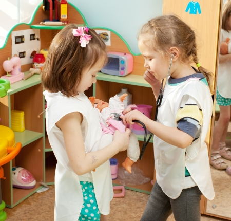 day care: Child in kindergarten. Kids in nursery school. Girl playing at infant school