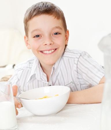 replenishment: Child eating frosted flakes at breakfast