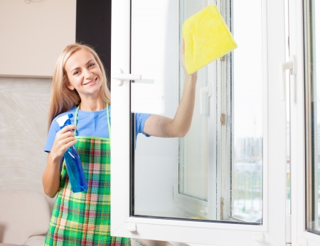 Woman washing window. Housewife cleaning window at home. Housework photo