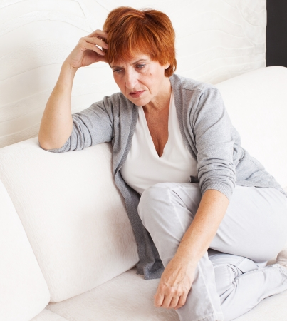 only mature women: Sad adult woman at home Stock Photo
