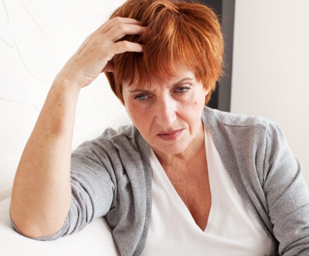 only one senior: Sad adult woman at home Stock Photo
