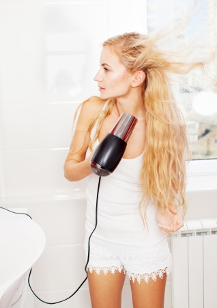 Woman dry hair hairdryer at bathroom Stock Photo - 19502333