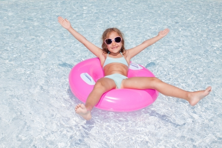 Happy little girl in pool. Vacations