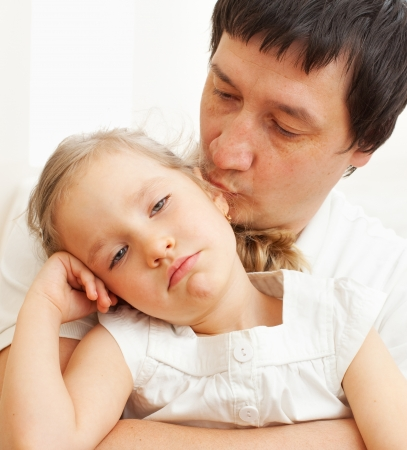 Father comforts a sad girl. Problems in the family Stock Photo - 21282488