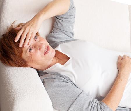 mature women only: Adult woman has a headache. Sad mature female Stock Photo