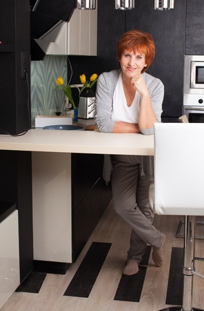 Female cooking at kitchen. Woman at home photo