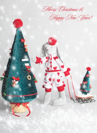 Hare dress up the tree. Christmas Card Stock Photo - 21234183
