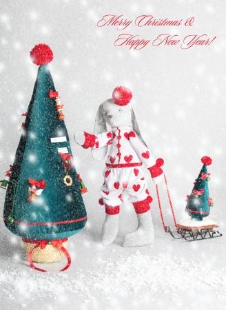 Hare dress up the tree. Christmas Card Stock Photo - 21234183