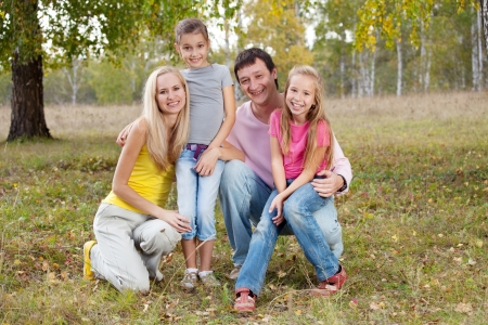 Happy family with children in autumn park photo