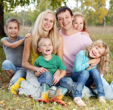 large family: Happy large family with children in autumn park Stock Photo
